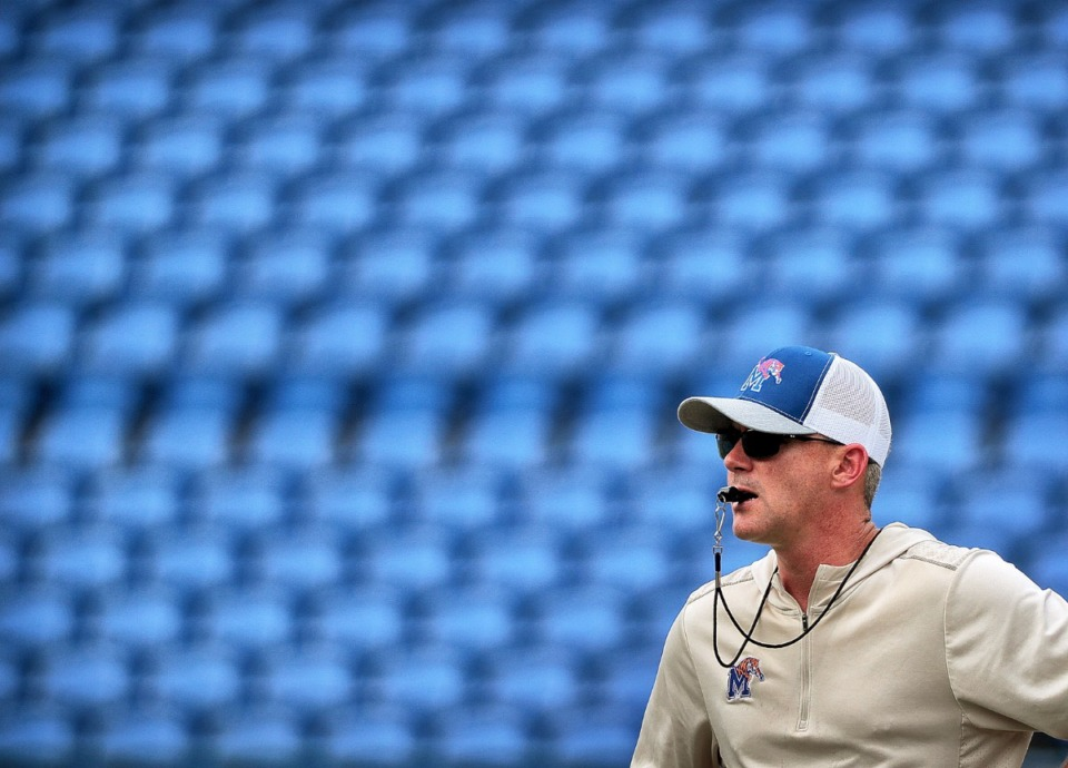 <strong>Head coach Mike Norvell runs his team through drills before the start of the Memphis Tigers football team's annual scrimmage and fan fest at the Liberty Bowl Stadium on Aug. 10, 2019.</strong>&nbsp;<strong>The Tigers will end two weeks of fall camp at the&nbsp;University of Memphis Lambuth Campus in Jackson, Tenn., with a few days of leadership and bonding activities.</strong> (Jim Weber/Daily Memphian)