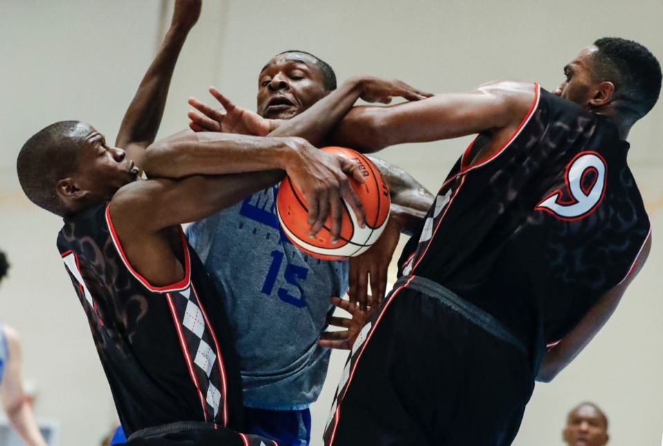 <strong>Memphis Tigers forward Lance Thomas (middle) is fouled while driving the lane against Commonwealth Bank Giants defenders Karon Pratt (left) and D&acirc;Shon Taylor (right) in the exhibition game in Nassau, Bahamas, Wednesday, Aug. 14, 2019.</strong> (Mark Weber/Daily Memphian).