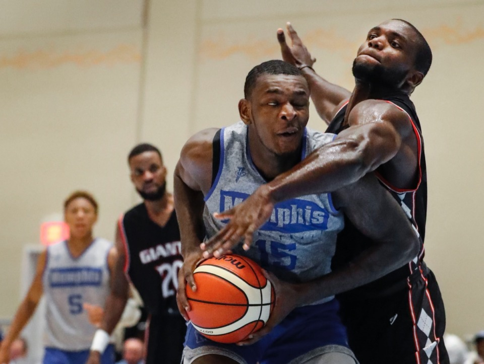 <strong>Memphis Tigers forward Lance Thomas (left) is fouled by Commonwealth Bank Giants defender Mavin Saunders (right) Wednesday.</strong>&nbsp;<strong>Coach Hardaway named him team captain before the game.</strong> (Mark Weber/Daily Memphian).
