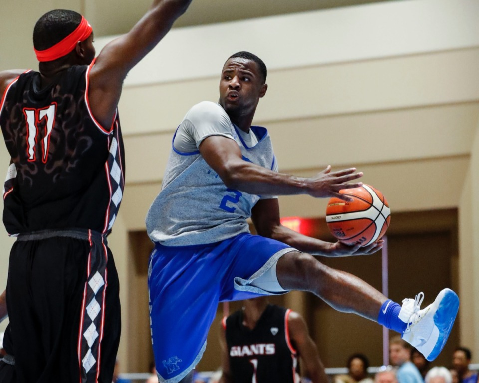 <strong>Memphis Tigers guard Alex Lomax (right) looks to make a pass around Commonwealth Bank Giants defender Cormardo Seymour (left) in the Tiger victory Wednesday in the Bahamas.</strong>&nbsp;<strong>Lomax contributed nine points and five steals.</strong> (Mark Weber/Daily Memphian).