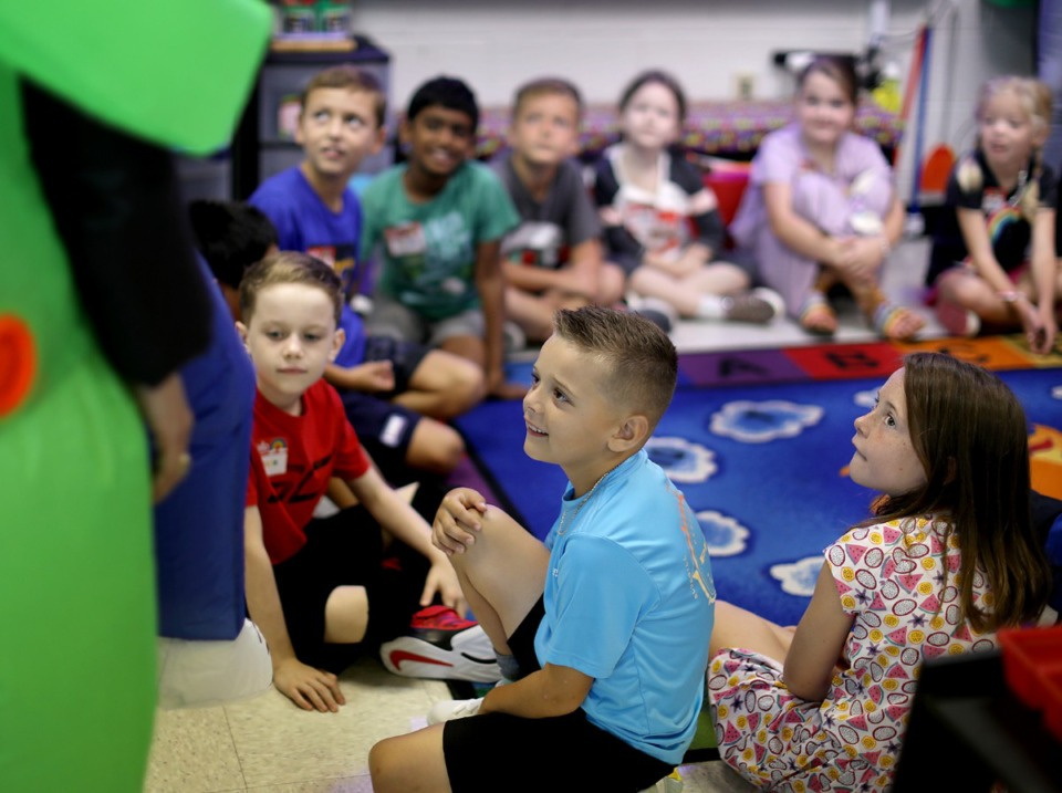 <strong>Not all of the kids in Mrs. Wright's second grade class knew what to think of Tara Oaks Elementary principal Tricia Marshall's alien costume at first, but after they warmed up, it helped break the ice during the Collierville school's first day of classes Monday, Aug. 12.</strong> (Patrick Lantrip/Daily Memphian)