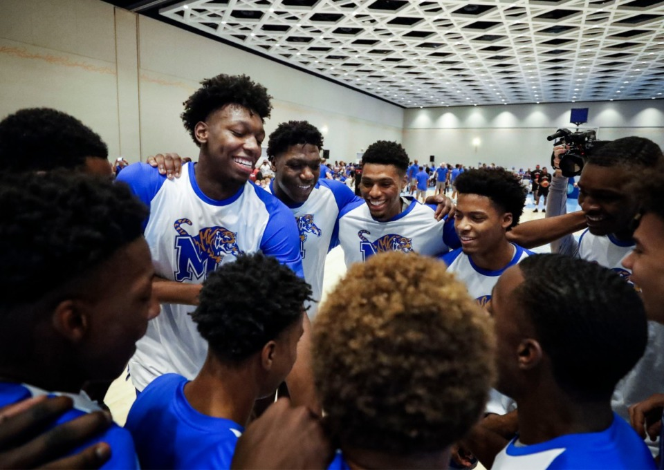 <strong>Memphis Tigers teammates (from left) James Wiseman, Malcolm Dandridge, Ryan Boyce and Jayden Hardaway hype themselves up during a team huddle before taking on the Commonwealth Bank Giants in an exhibition game in Nassau, Bahamas, on Wednesday, Aug. 14, 2019.</strong> (Mark Weber/Daily Memphian)