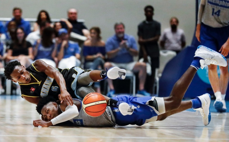 <strong>Memphis Tigers guard Damion Baugh (bottom) battles NPBA Select guard Terrell Butler (top) for a loose ball exhibition game in the Bahamas &nbsp;Thursday.&nbsp;</strong>(Mark Weber/Daily Memphian)