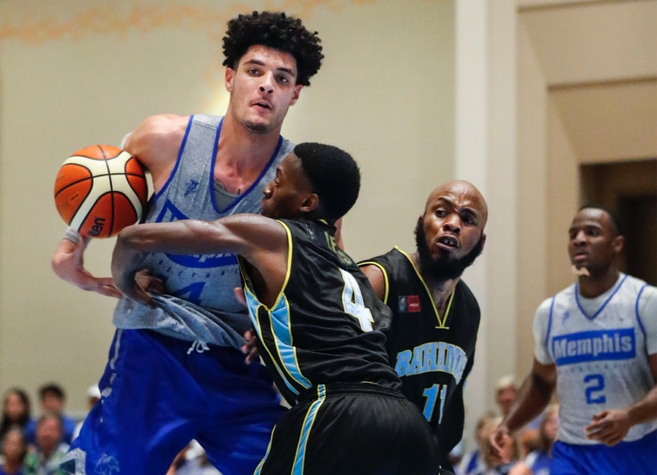 <strong>Memphis Tigers forward Isaiah Maurice (left) drives the lane against NPBA Select defender Abel Joesph (middle) during &nbsp;in Nassau, Bahamas, Thursday.</strong>&nbsp;<strong>Maurice finished with 21 points and 12 rebounds.</strong> (Mark Weber/Daily Memphian)