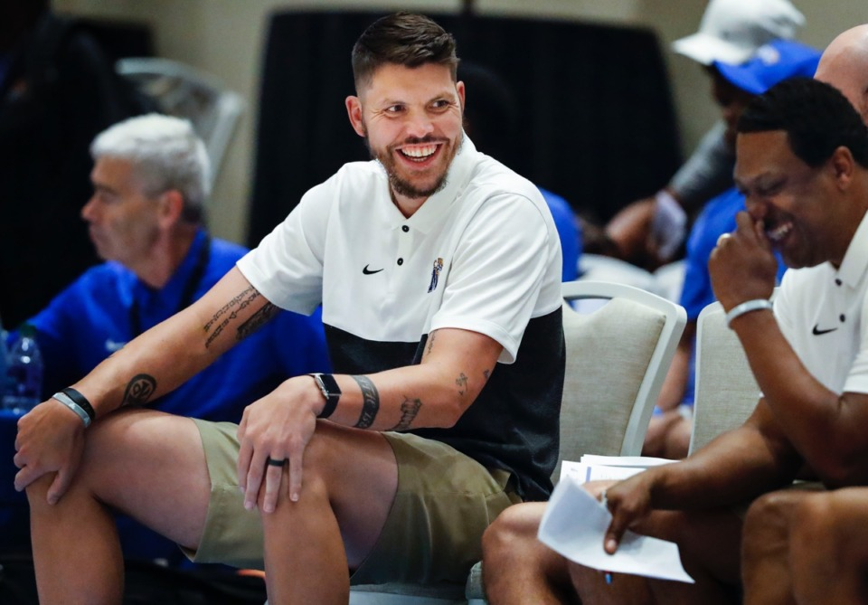 <strong>Memphis Tigers assistant coach Mike Miller (left) jokes on the bench during the exhibition game Thursday in the Bahamas.</strong> (Mark Weber/Daily Memphian).