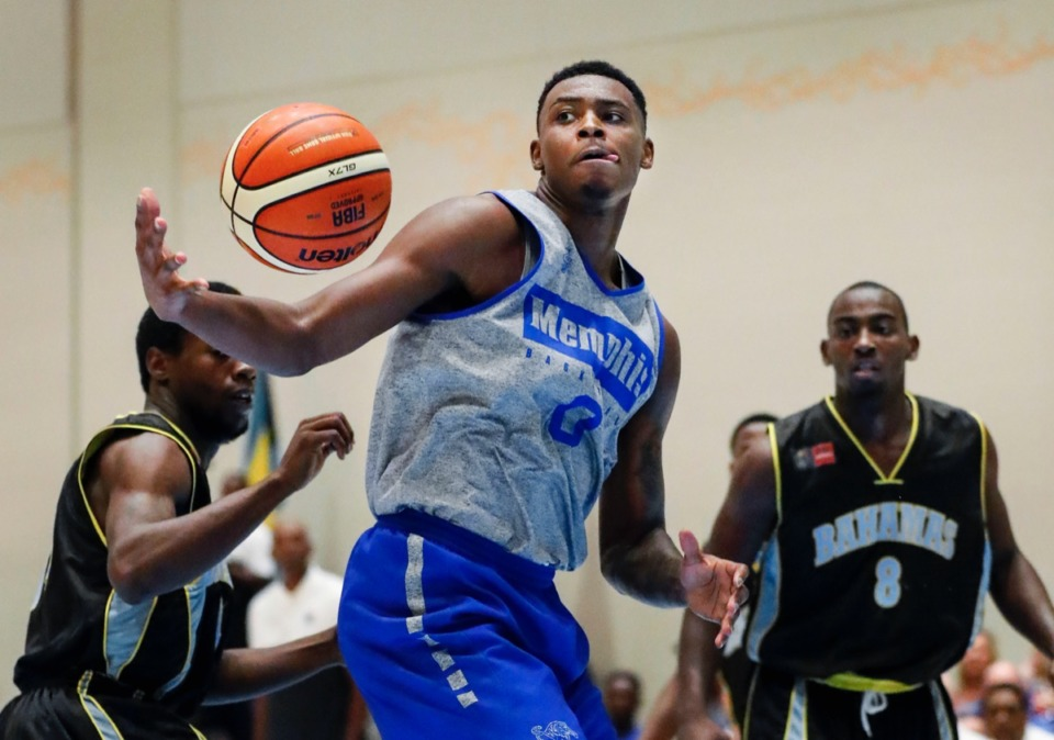 <strong>Memphis Tigers forward Lance Thomas (middle) drives the lane against NPBA Select defender Devon Ferguson (right) in the B ahamas Thursday.</strong> (Mark Weber/Daily Memphian)