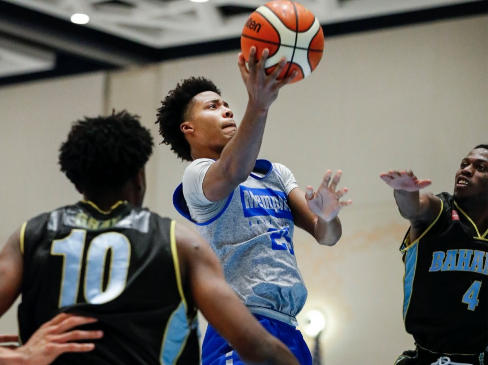 <strong>Memphis Tigers forward Jayden Hardaway (middle) drives for a layup against the NPBA Select defense Thursday.</strong> (Mark Weber/Daily Memphian)