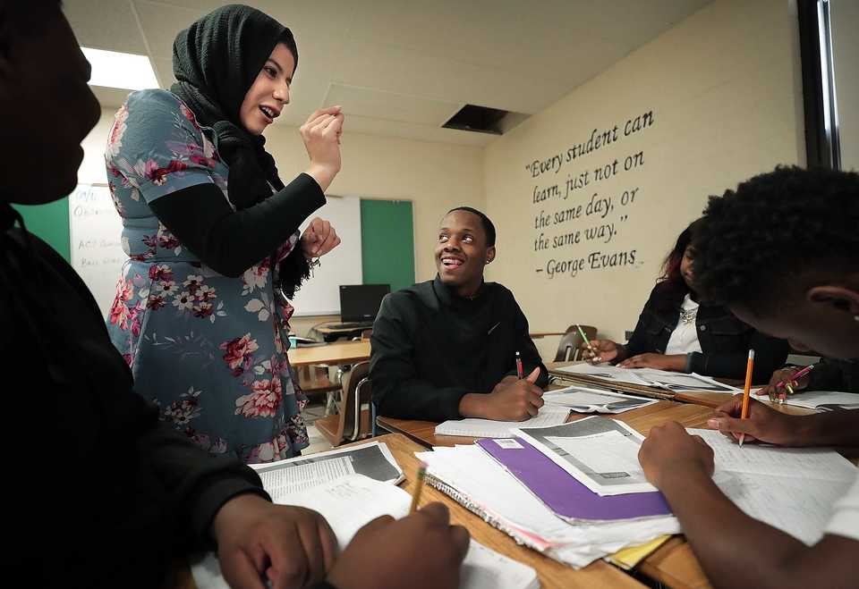 <strong>Peer Power Success Coach Abeer Abdelrahim works with students in Nicole Ford's biology class at Whitehaven High School on September 14, 2018. Peer Power is an education nonprofit using in-class mentors to improve test scores and graduation rates in public schools.</strong> (Jim Weber/Daily Memphian)