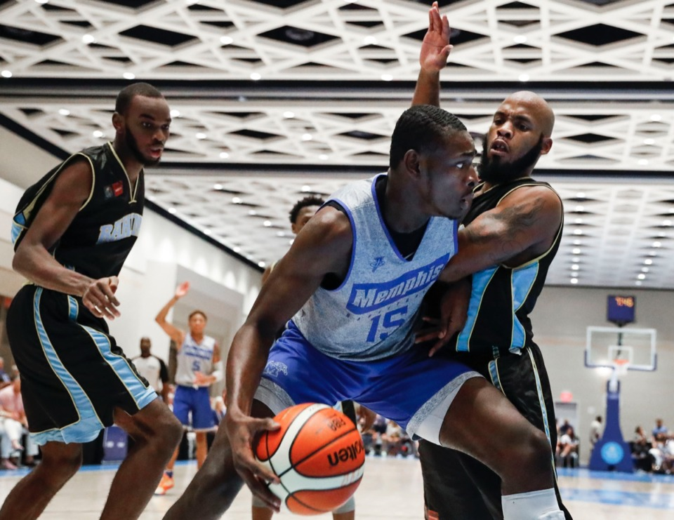 <strong>NPBA Select defender Devon Ferguson (right) tries to cover Tigers forward Lance Thomas (middle) in the exhibition game in Nassau, Bahamas, Thursday, August 15, 2019.</strong> (Mark Weber/Daily Memphian).