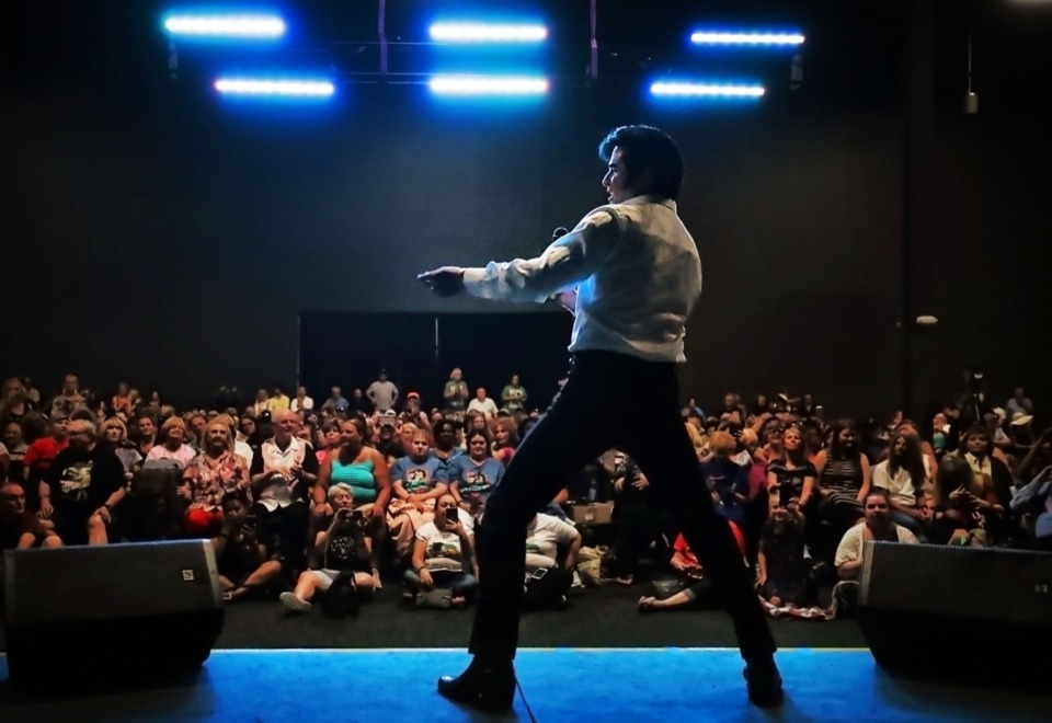 <strong>Elvis Presley tribute artist Dean Zeligman performs for a crowd of die-hard fans at the Graceland Exhibition Center on Aug. 15, 2019 during the annual Elvis Week events to memorialize the 42nd anniversary of the King of Rock 'n' Roll's death.</strong> (Jim Weber/Daily Memphian)