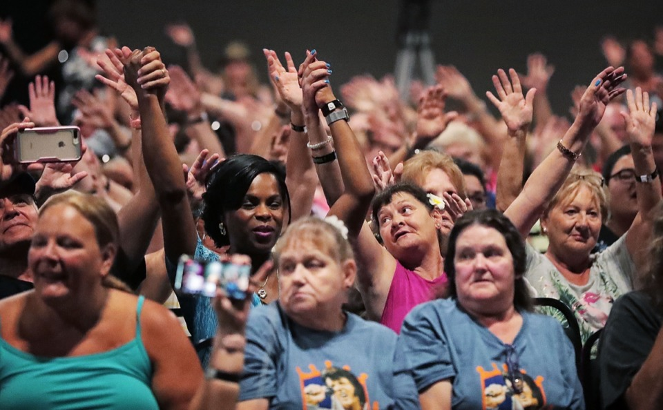 <strong>Fans sing along during Elvis Presley tribute artist Dean Zeligman's performance at the Graceland Exhibition Center on Aug. 15, 2019.</strong> (Jim Weber/Daily Memphian)