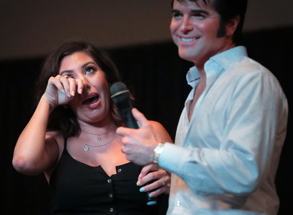 <strong>Stephanie Zeligman got emotional while singing a duet with her husband, Elvis Presley tribute artist Dean Zeligman, at the Graceland Exhibition Center on Aug. 15, 2019.</strong> (Jim Weber/Daily Memphian)
