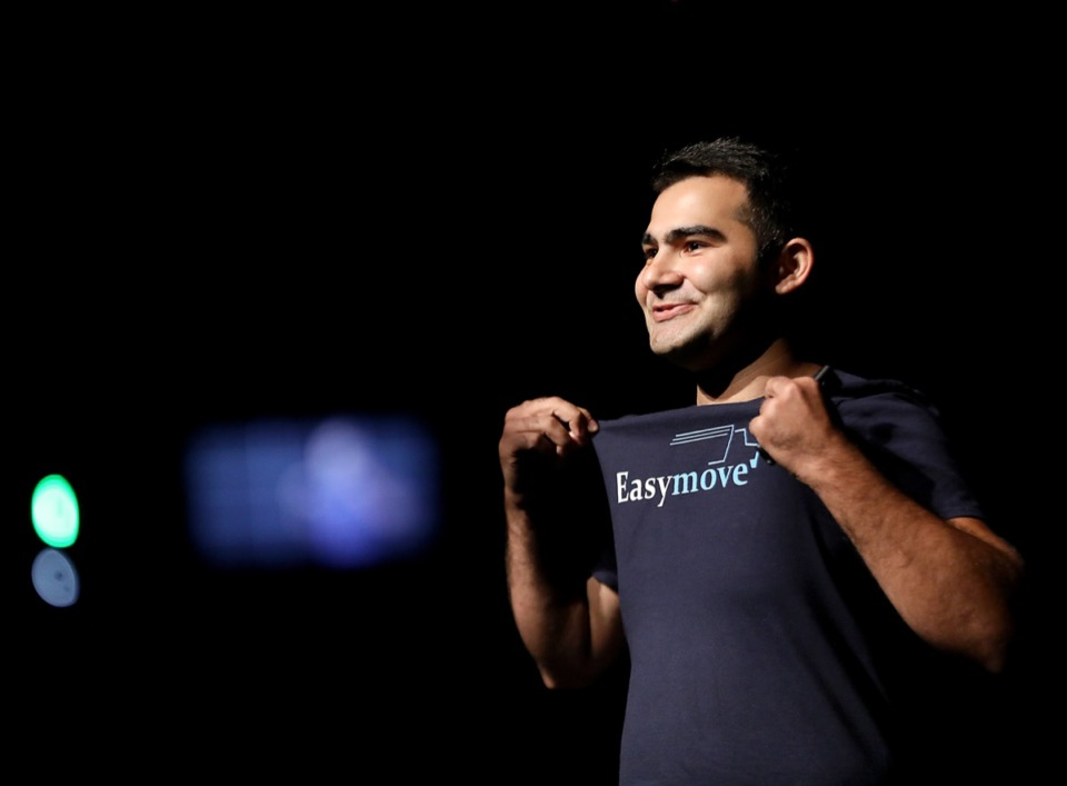<strong>Emin Aliyev, founder of EasyMove, proudly finishes his Demo Day pitch with a smile at the Halloran Centre for Performing Arts &amp; Education Thursday, Aug. 15, 2019. He was looking for $550,000 in investments.</strong> (Patrick Lantrip/Daily Memphian)