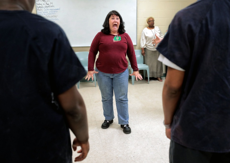 <strong>Carmen Mandley (center), with the Tennessee Shakespeare Company, gets her students warmed up with facial exercises while working on a speech project with juveniles being housed at Jail East on Aug. 14. The Tennessee Shakespeare Company recently received a grant to work with juveniles in Shelby County Juvenile Court.</strong> (Jim Weber/Daily Memphian)