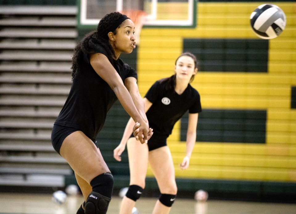 <strong>Aliyah Wells, a senior volleyball player at Briarcrest, leaps to hit the ball back over the net during a practice in the school's gym. Wells has committed to Alabama with a full scholarship to play volleyball at the school.</strong> (Daily Memphian file)