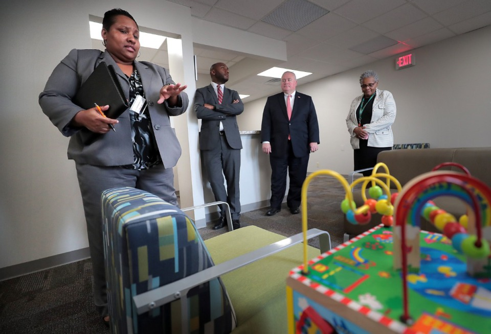 <strong>Director of Community Initiatives for the Youth Advocacy Center Kena Vassar (left) guides Shelby County Mayor Lee Harris (center) and Commissioner Mark Billingsley through a tour of the new center on August 13, 2019. The center is a pilot program that will try to keep young people out of the juvenile justice system through mental health evaluation and intervention.</strong> (Jim Weber/Daily Memphian)