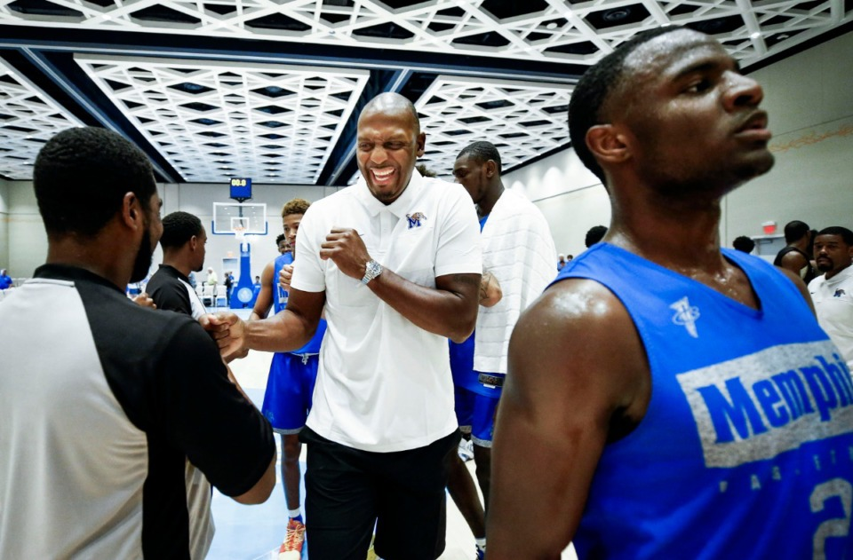 <strong>Memphis Tigers head coach Penny Hardaway (middle) jokes with the officials after beating Raw Talent Elite 107-77 in their exhibition game in Nassau, Bahamas, Sunday, August 18, 2019.</strong> (Mark Weber/Daily Memphian)