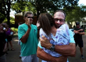 <strong>Golfer Doug Barron hugs his wife Leslie, who surprised him with a large gathering of friends, family and firefighters outside of their Germantown home as Barron returned home Monday, Aug. 19, after winning the Dick's Sporting Goods Open.</strong> (Patrick Lantrip/Daily Memphian)