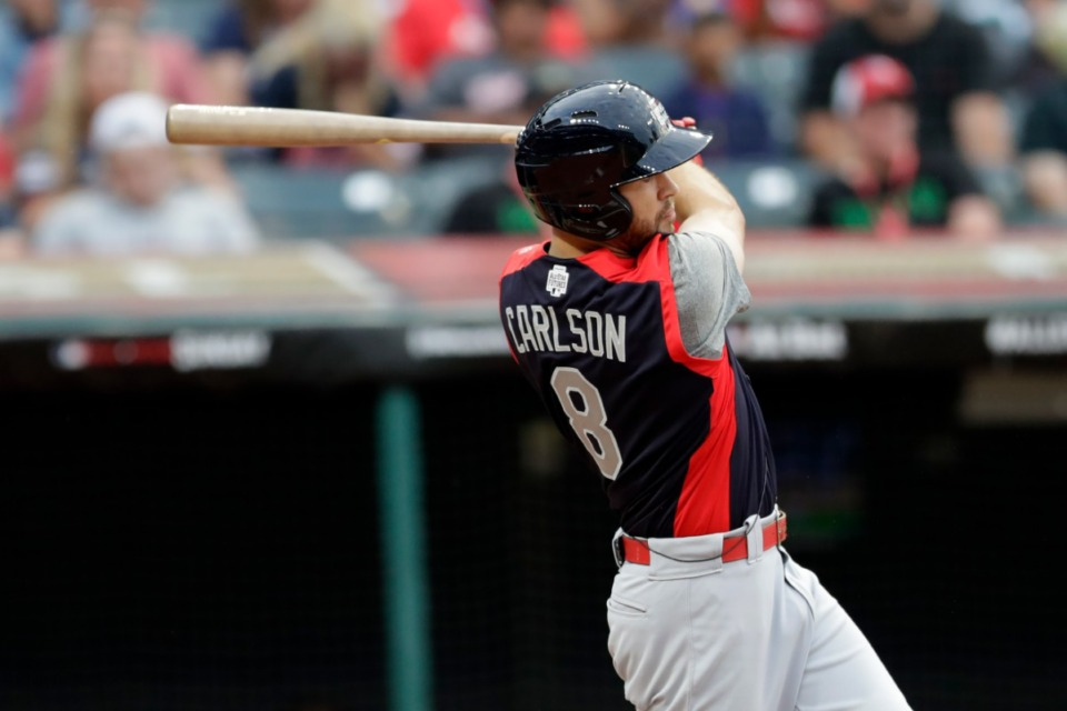 <strong>Dylan Carlson, of the St. Louis Cardinals, hits an RBI-single during the fourth inning of the MLB All-Star Futures baseball Game on July 7 in Cleveland.&nbsp;Since being called up to the Triple-A Memphis Redbirds, the Cardinals' No. 2 prospect has gone 10-for-21 through his first five games with four extra-base hits.</strong>&nbsp;(Tony Dejak/Associated Press)