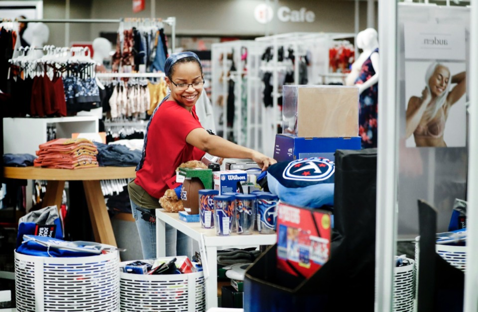 <strong>Visual merchandiser Debra Powers sorts through college apparel at the Target store at 601 Colonial Road. The store recently went through a makeover that offers a new open layout.</strong> (Mark Weber/Daily Memphian)