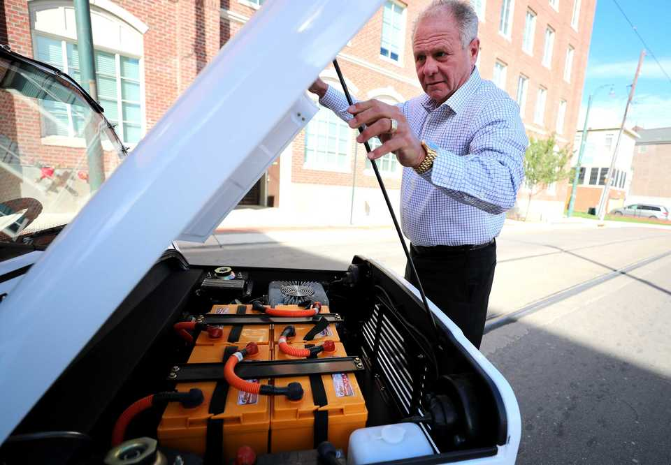 <strong>Mike Hamby looks under the hood of his Moke electric car in downtown Memphis. The vehicle runs on four lithium batteries that can be charged via a 120-volt outlet.</strong>&nbsp;(Houston Cofield/Daily Memphian)