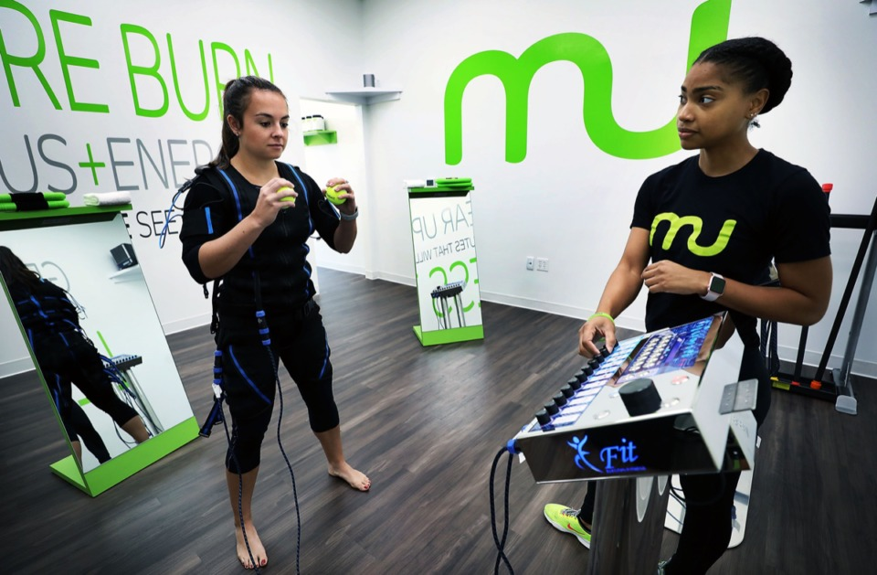 <strong>Trainer Amber Paxton leads an electrical stimulation workout with client Caroline Doherty at Manduu's 575 S. Perkins Rd. location Monday, Aug. 19.</strong> (Patrick Lantrip/Daily Memphian)