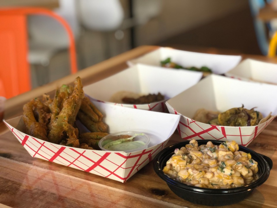 <strong>Fried okra (front left), equites (front right) and numerous tacos are on the menu at El Mero Taco in Cordova.</strong> (Jennifer Biggs/Daily Memphian)