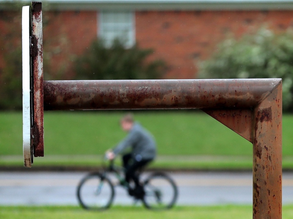 <strong>A bicyclist pedals by Farmington Park. Germantown's Parks and Recreation Commission Thursday voted to amend the rules for how the public can use the parks during the recess time of nearby schools.</strong>&nbsp;(Jim Weber/Daily Memphian)