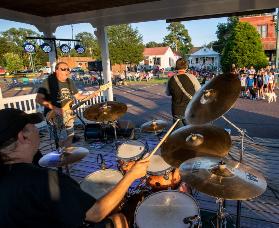 <strong>Memphis band Area 51 performs on the gazebo stage during Arlington's Music On The Square series Aug. 17, 2019. Band members are (from left) Pete Mendillo, drums; Randy Byrum, bass; Josh Haynes, guitar and vocals, and (not pictured) David Haynes, keyboards.</strong> (Mike Kerr/Special to The Daily Memphian)