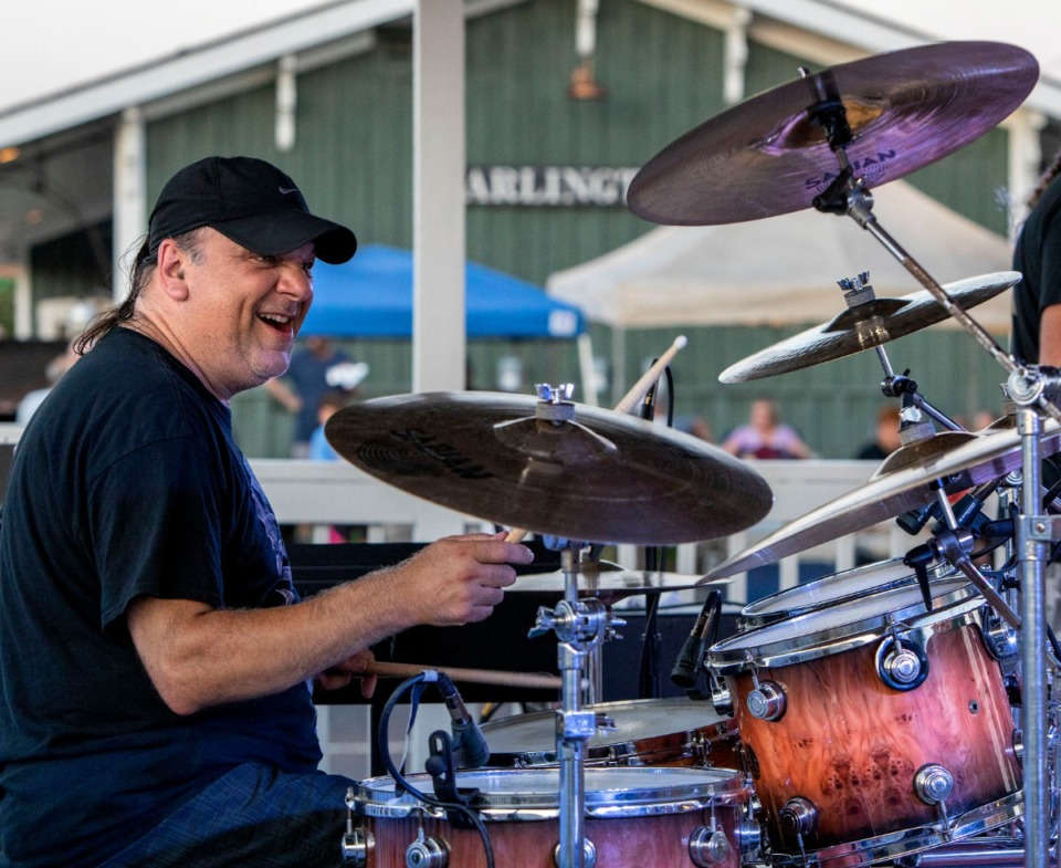 <strong>Pete Mendillo keeps the beat as Memphis band Area 51 covers songs by Yes, Journey and other classic rock artists during Arlington's Music On the Square series Aug. 17, 2019.</strong> (Mike Kerr/Special to The Daily Memphian)