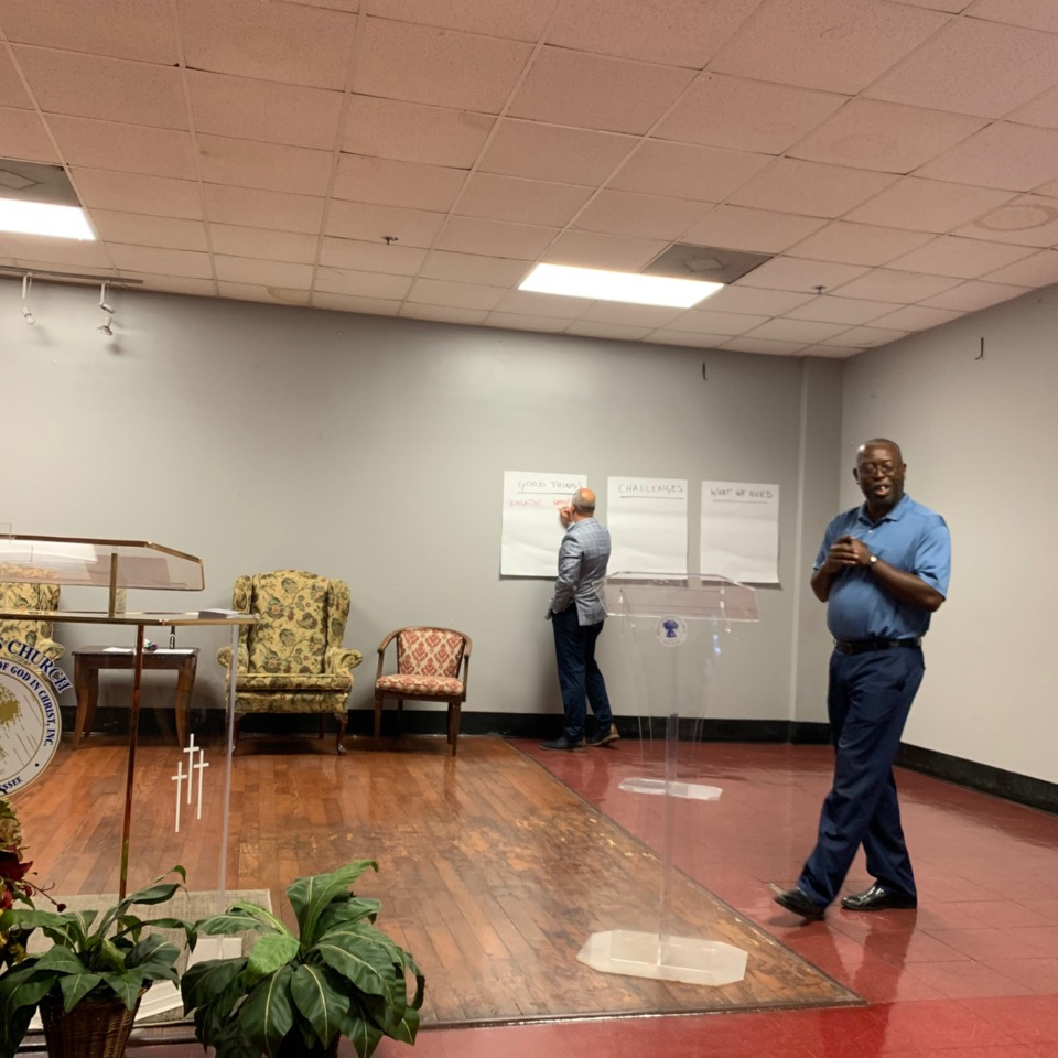 <strong>Charles Everett (right) gets community feedback during an Uplift Westwood town hall meeting, while Michael Deutsch takes notes on a whiteboard. </strong>(Elle Perry/Daily Memphian)