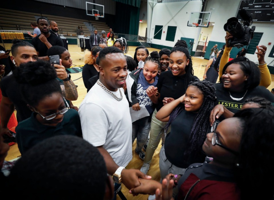 <strong>Memphis rapper Yo Gotti (middle) greets students at Grandview Heights Middle School after donating uniforms to each student Friday, Aug. 23.</strong> <strong>The recording artist surprised more than 300 students at the school, his alma mater.</strong> (Mark Weber/Daily Memphian)