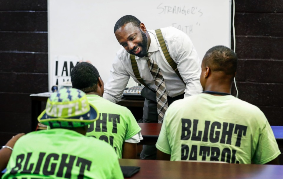 <strong>Lifeline to Success founder DeAndre Brown (top) speaks to participants in the program's Blight Patrol during class Wednesday.</strong> (Mark Weber/Daily Memphian)