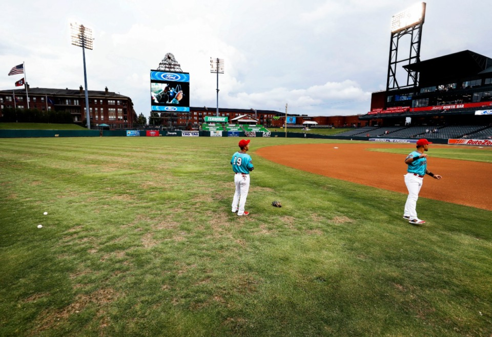 <strong>Memphis Redbirds players warm up on the patchy AutoZone Park field Thursday, Aug. 22. The field will be replaced before Memphis 901 FC&rsquo;s next home game Sept. 7.</strong> (Mark Weber/Daily Memphian)