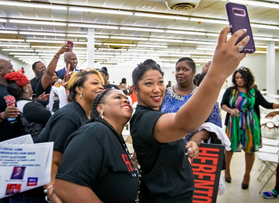 <strong>With former Memphis Mayor Willie Herenton in the background, Yolanda Askew holds a cell phone to take a group selfie with Kimberly (center of group) and Yolanda Houston at a Women for Herenton campaign event on Aug. 24, 2019, at Herenton's campaign headquarters at 3358 S. Third St.</strong> (Mike Kerr/Special to The Daily Memphian)