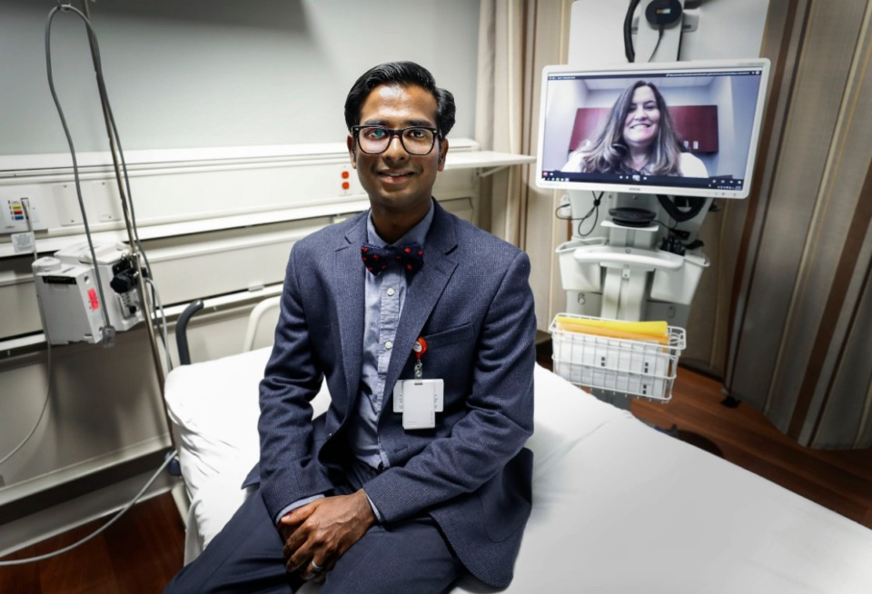<strong>Methodist Le Bonheur Healthcare physician Dr. Balaji Krishnaiah (right) along with nurse practitioner Wendy Dusenbury (screen) demonstrating how patients can see doctors using the Telestroke unit Aug. 20, 2019. The unit has technology that can connect doctors at the University Comprehensive Stroke Center to Methodist North, which means it will not have to transport patients to Midtown</strong>. (Mark Weber/Daily Memphian)