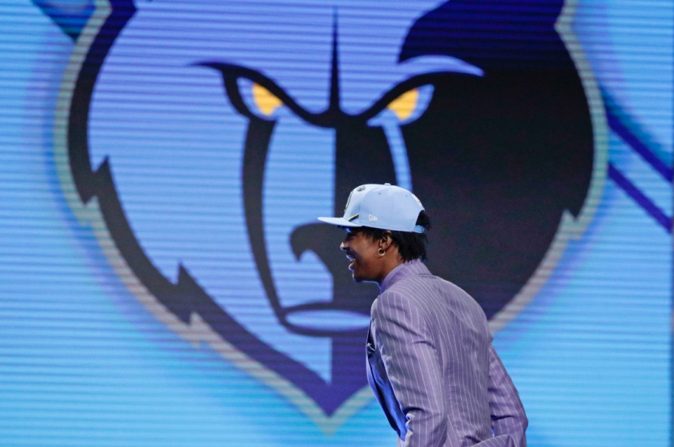Murray State's Ja Morant walks on stage after being selected with the second pick overall by the Memphis Grizzlies during the NBA basketball draft Thursday, June 20, 2019, in New York. (<strong>AP Photo/Julio Cortez</strong>)