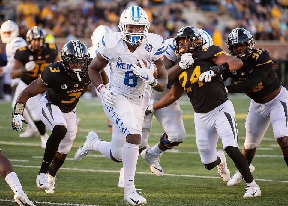 <strong>Memphis running back Patrick Taylor Jr. scrambles past Missouri defenders for a touchdown during the second half of an NCAA college football game Saturday, Oct. 20, 2018, in Columbia, Mo. Missouri won the game 65-33.</strong> (AP Photo/L.G. Patterson)