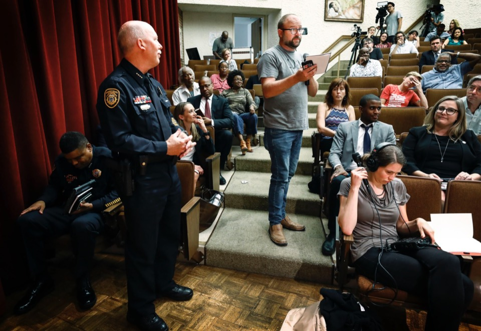 <strong>Activist Hunter Demster (center) reads the notes of Memphis Police Deputy Chief Don Crowe (left), at a public forum July 11 discussing MPD's surveillance conduct at Mississippi Boulevard Christian Church.</strong> (Mark Weber/Daily Memphian).