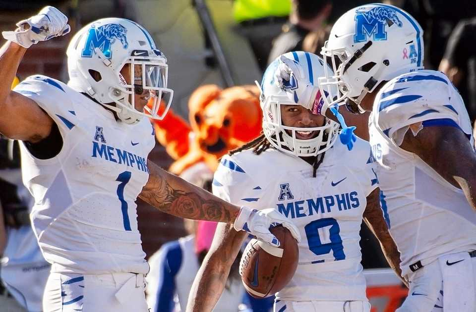 <strong>Memphis wide receiver Tony Pollard, left, celebrates his touchdown with teammates during the first half of an NCAA college football game against Missouri, Saturday, Oct. 20, 2018, in Columbia, Mo.</strong> (AP Photo/L.G. Patterson)
