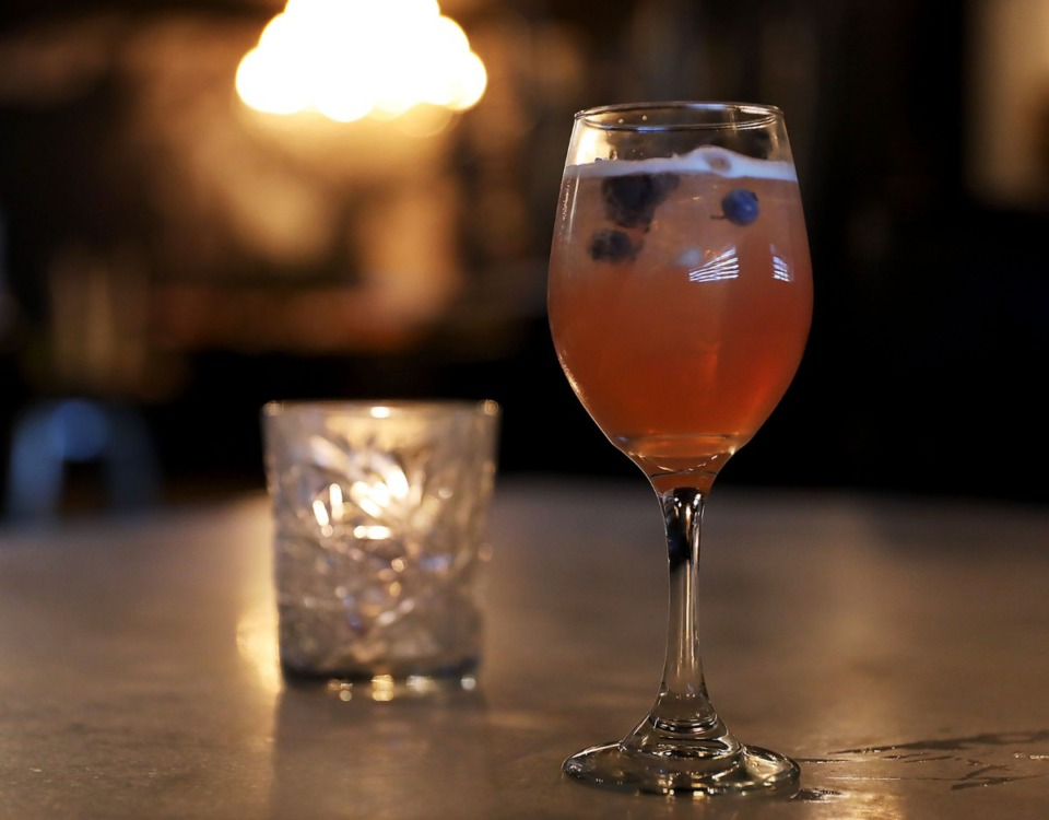 <strong>A Blue Flower with bourbon, blueberry syrup, lime, elderflower and prosecco made by Silly Goose bartender Jeff Barber.</strong> (Patrick Lantrip/Daily Memphian)