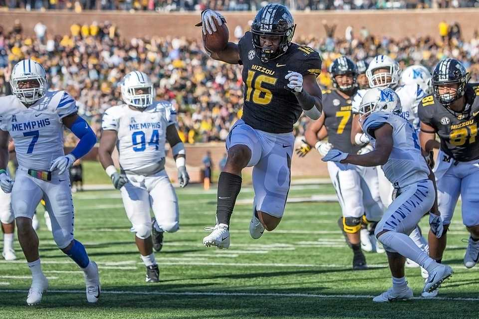 <strong>Missouri Tigers running back Damarea Crockett (16) leaps into the end zone for a touchdown during the first half of a college football game against the Memphis Tigers Saturday, Oct. 20, 2018, in Columbia, Missouri.</strong>&nbsp; (Icon Sportswire via AP Images)
