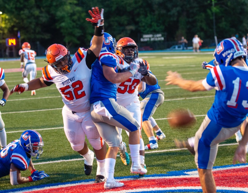 <strong>Ridgeway High School defensive tackle Cody Daniels (52) and Cameron Daniels (50) try to block a punt by MUS kicker Ben Skahan (13) at MUS Aug. 23. MUS won, 53-3.</strong> (Greg Campbell/Special to the Daily Memphian)