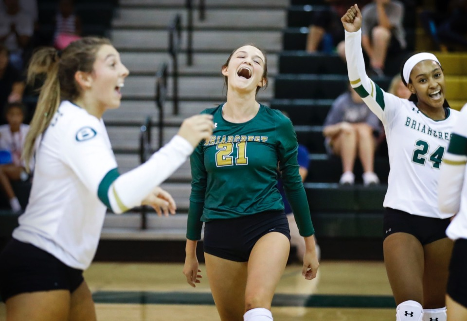<strong>Briarcrest teammates (from left) Loren Robertson, Emma Perkins and Zykia Jones celebrate a point against Houston in a volleyball game Thursday, Aug. 29.</strong> (Mark Weber/Daily Memphian)