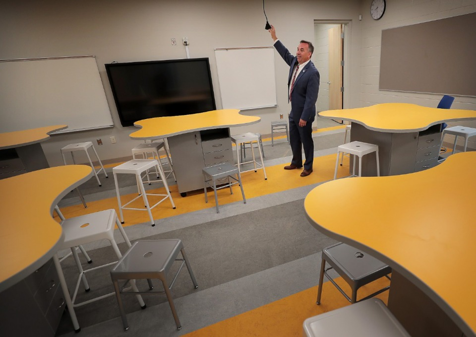 <strong>More than $41 million in capital projects were completed this summer at five of Germantown Municipal School District&rsquo;s six schools. The work included completion of the $30 million Forest Hill Elementary, where Germantown schools superintendent Jason Manuel shows off some of the innovations.</strong> (Jim Weber/Daily Memphian file)