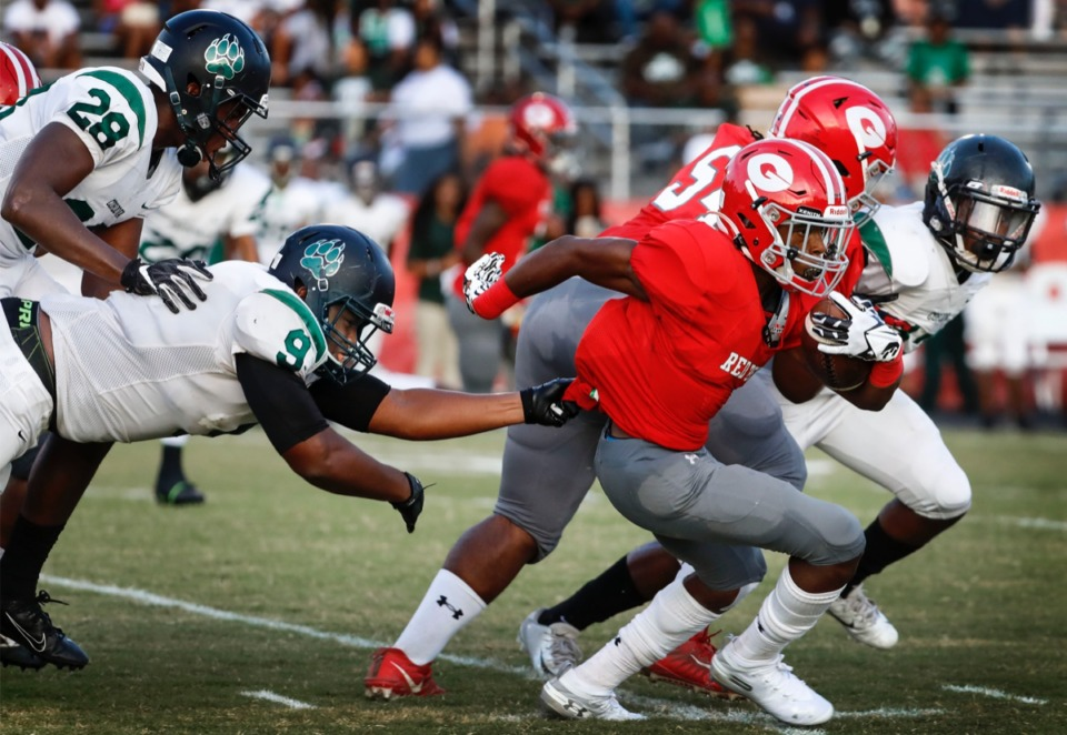 <strong>Cordova defender Rodkerion Lucas (left) uses one hand to bring down Germantown running back T.J. Dorsey (right) at Germantown High School Friday, Aug. 30.</strong> (Mark Weber/Daily Memphian)