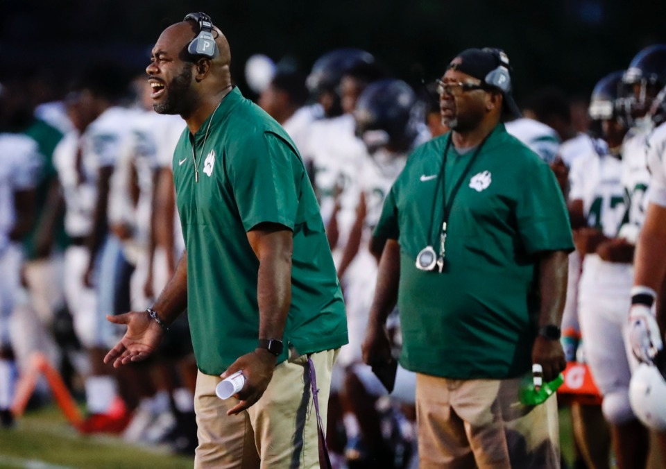 <strong>Cordova head coach Marcus Wimberly (left) reacts during the game against Germantown Friday, Aug. 30.</strong> (Mark Weber/Daily Memphian)