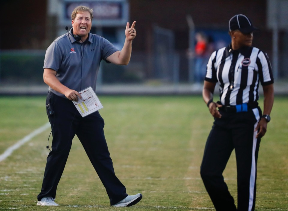<strong>Germantown head coach Chris Smith argues a call with an official Friday, Aug. 30, in the game against Cordova.</strong> (Mark Weber/Daily Memphian)