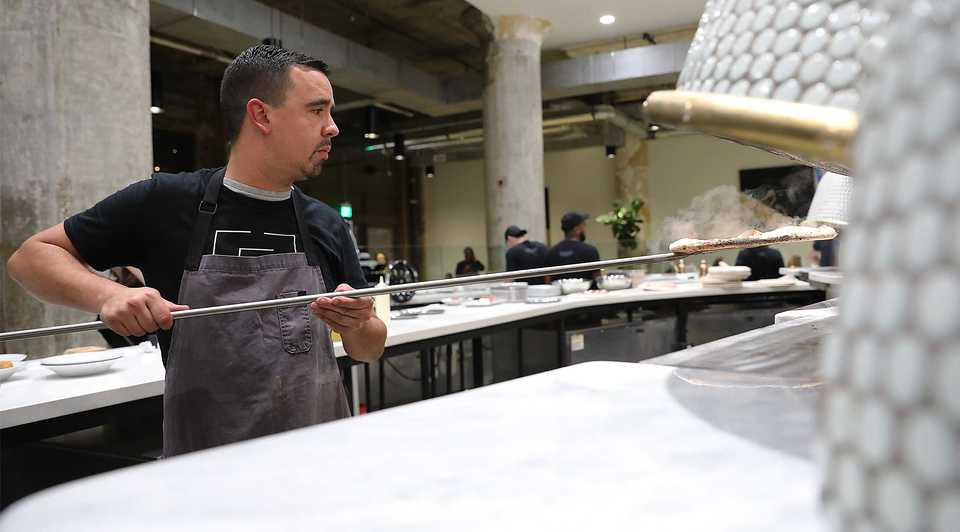 <strong>Sebastian Knox prepares a fresh Neapolitan pizza during Elemento&rsquo;s soft opening Monday, Oct. 15. </strong>(Patrick Lantrip/Daily Memphian.)