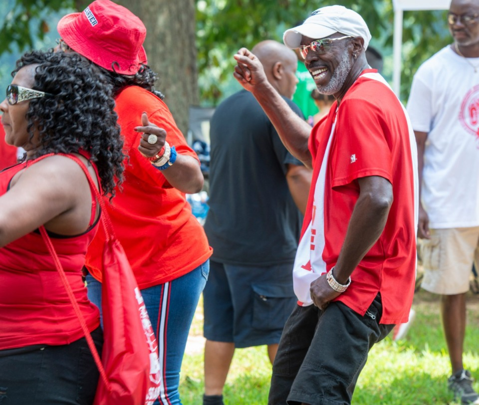 <strong>Vincent Butler, class of 81, does a little line dancing with former classmates at the Carver High School reunion at Martin Luther King Park Saturday.</strong> (Greg Campbell/Special to The Daily Memphian)